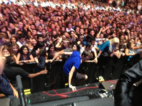 Fans climbing on stage